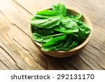 bowl of fresh spinach leaves on ... | Shutterstock . vector #292131170