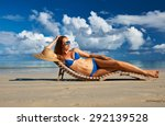 Woman In Bikini Lying On...