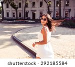 happy woman in sunglasses and... | Shutterstock . vector #292185584