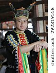 Small photo of Kota Kinabalu, Sabah Malaysia.May 30, 2015 : Dusun Tindal man in elaborated colorful traditional costume during Pesta Kaamatan or Harvest Festival in Sabah Borneo