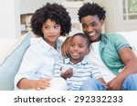 happy family on the couch at... | Shutterstock . vector #292332233