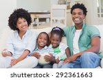 happy family watching... | Shutterstock . vector #292361663