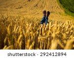 female legs on wheat field | Shutterstock . vector #292412894