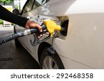 hand refilling the car with... | Shutterstock . vector #292468358