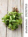 fresh mint on grey wooden...   Shutterstock . vector #292507013