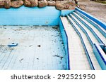 A Derelict Swimming Pool In An...