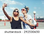 Two Young Women Taking Selfie...