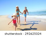 family having fun running on a... | Shutterstock . vector #292625324