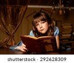 little girl in a blue dress on... | Shutterstock . vector #292628309
