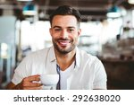 handsome man having a coffee at ... | Shutterstock . vector #292638020