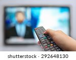 man hand switches tv channels.... | Shutterstock . vector #292648130