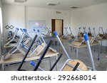 """Small photo of A whiteboard in a scholastic empty classroom with the message """"welcome back to school"""" written with red and green marker symbolizing the end of the school and the start of the summer holidays"""