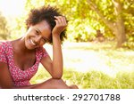 young woman sitting on grass... | Shutterstock . vector #292701788