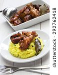 Small photo of chicken and pork adobo over yellow rice, filipino food