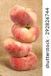 Saturn Peach - Doughnut peach stack on a rustic background - stock photo