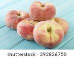 Saturn Peach - Doughnut peaches on a blue background. - stock photo