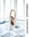 woman stretching in bed after... | Shutterstock . vector #292934804