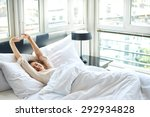 Woman Stretching In Bed After...