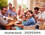 family and friends sitting at a ... | Shutterstock . vector #292953494