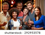 adult friends drinking at a... | Shutterstock . vector #292953578