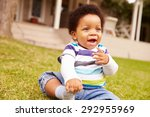 toddler sitting on the grass in ... | Shutterstock . vector #292955969