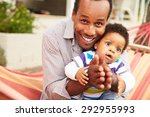 father bonding with young son... | Shutterstock . vector #292955993