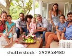 family and friends posing for a ... | Shutterstock . vector #292958480