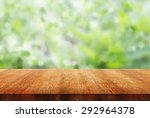 wooden table top on blurred... | Shutterstock . vector #292964378