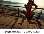 young fitness woman legs... | Shutterstock . vector #292977650