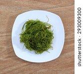 fresh seaweed salad on white...   Shutterstock . vector #293009300