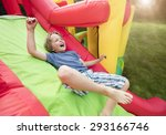 Boy Jumping Down The Slide On...