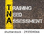 Concept image of Business Acronym TNA as Training Need Assessment written over road marking yellow painted line.