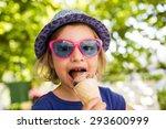 little girl  licking ice cream... | Shutterstock . vector #293600999