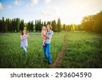 family playing with a kite... | Shutterstock . vector #293604590