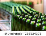 many bottles on conveyor belt... | Shutterstock . vector #293624378