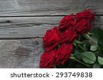 Stock photo red roses on a wooden board 293749838