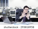 young businessman with scared... | Shutterstock . vector #293818958
