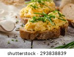 scrambled eggs with herbs on... | Shutterstock . vector #293838839