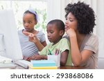 happy family using the computer ... | Shutterstock . vector #293868086