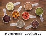 Stock photo superfood abstract wheatgrass acai berry goji berry falx seed chia seed goldenberry hemp seed 293963528