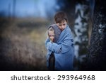 two sad little embracing... | Shutterstock . vector #293964968