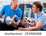 senior man and trainer at... | Shutterstock . vector #293986088