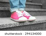 female feet in pink gumshoes on ... | Shutterstock . vector #294134000