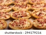 mini pizzas on  a baking paper... | Shutterstock . vector #294179216
