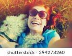 Young Woman Taking Selfie With...