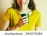 Young Girl Drinking Green...