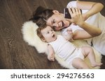 woman with a baby doing a... | Shutterstock . vector #294276563