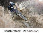 mountainbiker rides on path in... | Shutterstock . vector #294328664