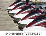Group Of Jet Skis On Dock For...