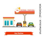 petrol station with two cars....
